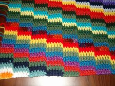 A way to use up scraps that I designed. Useful as a lap robe, afghan baby blanket or wrap.