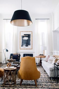 Simple shades of blue, white and mustard yellow work perfectly in a living room along with the additional of metal accents.