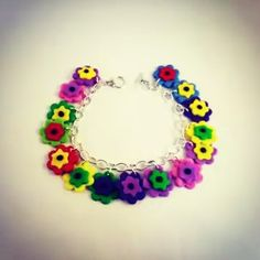 Special gifts online signature charm bracelets. Fimo flower bracelet. Very cute gift idea @ http://www.specialgiftsonline.co.uk/  #shop #charmbracelets #armcandy #specialgiftsonline #giftideas #fimo #flowers #handmadegifts