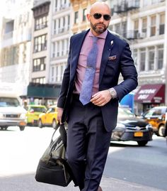 Spring time in New York City  Photo: @kathleen_oneill   Lapel pin: @finzaklifestyle  Bag: @lexdray  Belt: @ansonbelt  Shirt: @trashness  Tie: @yellowhookneckties