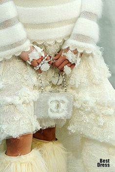 Incredible sweater, lace skirt, purse and jewellery, all these textures, all piled on, is the genius of Lagerfeld for Chanel