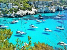 Menorca, Spain is Balearic Islands that happens to belong to Spain. it is located in the Meditteranian Sea. it is known for its clear blue water, where you can literally see the boats floating in midair but it is only the water that is making that illusion.