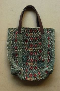 woven, lined tote bag with leather handles
