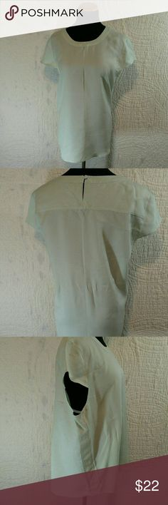 J Crew Drape Oxford Crepe Cap Sleeve Top Size XL This top is a light turquoise color. It has capped sleeves with one button in the back. This top is currently sold out J. Crew Tops