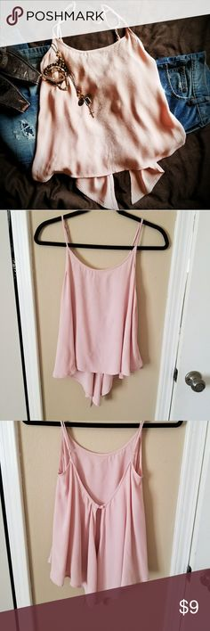 Split Back Flowing Top ☀️Summer Fun Sale ☀️  Split Back Flowing Top with adjustable straps and loop and button closure in the back. Front measures approximately 20 inches and the back measures approximately 25 inches at the longest point. 100% rayon. See photo for care instructions. Tops