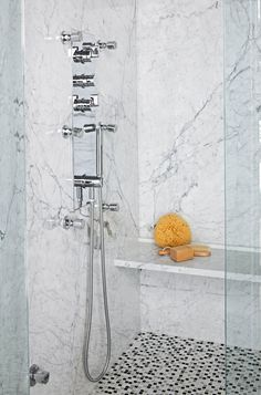 Seats in walk-in showers should be at least 12 inches deep and 14 inches high. This ledge-like seat, fashioned from the same marble used on the shower walls, provides handy seating without taking up too much visual or physical space in the walk-in shower. #showerremodel #showerbenchideas #bathroomideas #walkinshower #bhg Shower Seat, Diy Shower, Shower Faucet, Shower Doors, Shower Walls, Shower Benches, Shower Kits, Bath Shower, Small Bathroom With Shower