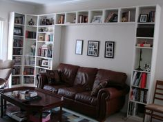 couch with bookcases surrounding it. | thirdconspiracy: Sold: IKEA Billy Bookcase