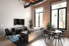 Brick living room - 729 N Sangamon St, Chicago, IL, 60642 – Brick living room Round Wooden Dining Table, Scandinavian Dining Chairs, Brick Loft, Modern Loft, Loft Spaces, Loft Apartments, Apartment Living, Bricks, Living Room Decor