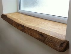 Something like this, stained darker for shelf in Master bathroom