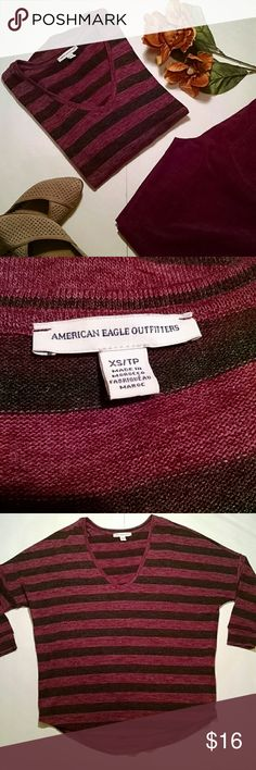 American Eagle shirt Burgundy and black heathered striped 3/4 length knit top. V-neck in the front, round hem at the bottom. Polyester/elastane. Excellent condition. Sz XS American Eagle Outfitters Tops