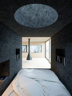 Mask House by WOJR. Sleeping nook with skylight. Lined with felt material.