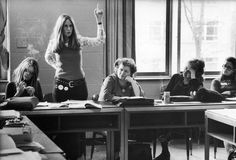 My friend New York lawyer Brenda Feigen Fasteau with her hand raised argues about candidate support while Ms. magazine editor Gloria Steinem (left),  NOW (National Organization for Women) President Wilma Scott Heide (center) & feminist/author Betty Freidan (second on the right) look on, during meeting of Caucus's National Policy Council, 1972.