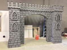 We just finished our Castle Facade. Measures 9 feet tall by 12 feet wide. Cardboard Box Houses, Cardboard Castle, Medieval Banquet, Medieval Party, Ganapati Decoration, Decoration For Ganpati, Castle Theme Classroom, Led Neon, Castle Party
