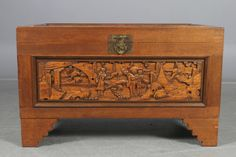 Chinese coffin with carvings. Unknown age, but am guessing early 1900. I also have a Swedish coffin similar to this one standing in the house. I love these for storing cables, batteries, guitar strings or simply just my VDSLR-rig. Also great to use as benches. I want to buy more coffins like this if I find similar size.