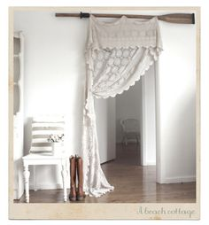 Hanging an old lace tablecloth. Gorgeous.
