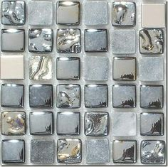 Awesome mosaic backsplash from Mirage Glass Tiles in NYC. 1x1 tiles are a combination of glass, metal and stone. Like jewelry for the kitchen or bath.