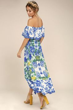 Take a trip to the tropics in the Antigua Blue Floral Print Off-the-Shoulder Dress! Lightweight woven rayon, with a bright floral print, shapes a flirty flounce, and an elasticized off-the-shoulder neckline. Elasticized waist tops a wrapping, high-low midi skirt.