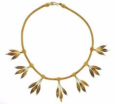 """An 18K yellow gold necklace with leaf motif stations.     DESIGNER: Ilias Lalaounis  MATERIAL: Gold  GEMSTONE:None  DIMENSIONS:Necklace is 16"""" long.  WEIGHT: 54.3 grams  MARKED/TESTED:Greece, Makers Mark, 750  CONDITION: Estate  PRODUCT ID: 17507"""