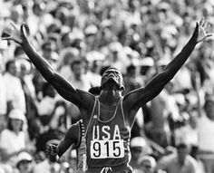 Carl Lewis raises his arms in victory as he wins a gold medal for the 200 meter. Lewis would win four gold medals at the 1984 Summer Games, and nine gold medals total over during his career.