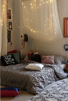 Tulle and Christmas lights make a magical bed backdrop.