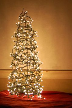 For the gardeners, here's a Christmas tree made from a tomato cage.