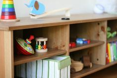 A Montessori Approach to Toys (or at least my attempt toards it) Types Of Flooring, Flooring Options, Toy Shelves, Wooden Shelves, Infant Classroom, Montessori Baby, Montessori Activities, Toy Organization, Organizing Toys