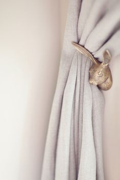 SourceSmall details like this bunny curtain hook really make the difference in creating an extra special nursery.