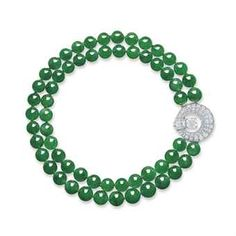 AN EXCLUSIVE DOUBLE-STRAND JADEITE BEAD AND DIAMOND NECKLACE Price Realized      HK$58,360,000 Set Currency     ($7,565,557)