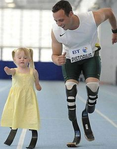 "An inspiring Oscar Pistorius moment: though he failed to qualify for the 400-meter Olympic final, the South African runner continues to be a role model for not only amputees but many others around the world.    This is an older photo, but the cute image of his ""race"" against a little girl with prosthetic legs like his just surfaced."