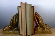Praying hands bookends