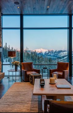 Pearson Design Group does a lot of mountain cabin lodge chalet homes....love this one with its steel framed views of the mountains.