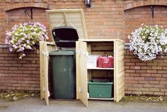 garbage shed - we'll need it painted white (like the fence). I like that lifting the top also lifts the trash can