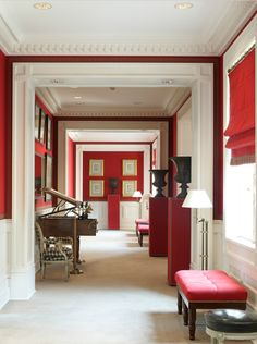 "Notice the Greek key trim and dentil moulding in this chic hallway. I love the ""Valentino Red"".}"