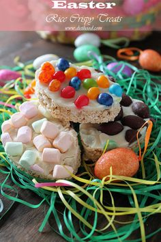Easter egg-shaped Rice Crispy Treats topped with melted white chocolate and a variety of jelly beans, marshmallows, and milk chocolates.