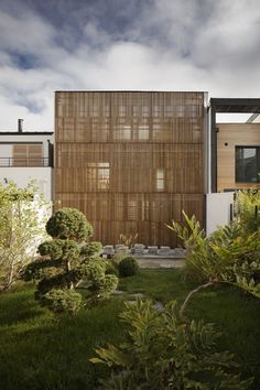 Maison M 02 Home with Vertical Shutters Built in a Village Garden