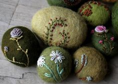 Stitching on stones.  My fingers seem to be looking forward to spring... flowers kept popping up.