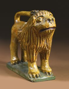 Esmerian collection. Sotheby's. 1/25/14. Lot 630. LION. Paint on pine. 7 3/8 by 7 1/2 by 3 in. WILHELM SCHIMMEL (1817-1890) 1860-1890. Carved in Cumberland County, Pennsylvania Estimate 80,000 — 120,000 USD LOT SOLD. 341,000 USD (Hammer Price with Buyer's Premium)