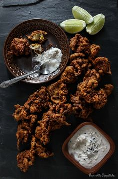 A crispy chicken and onion fritter made with chickpea flour & spices with a creamy coconut dipping sauce