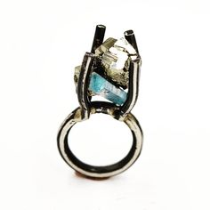 Art Jewelry:  Sterling silver ring, set with Peruvian Pyrite and blue Tourmaline