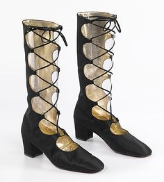 """British, silk boots from around 1968. """"... returned as an important fashion style in the early 1960s. The short skirts of the second half of the 1960s, and later hot pants, encouraged boot wearing. The leg of the boot tended to be closely contoured in the 1960s, and various forms of fitting were used to achieve this, whether by cut, stretch fabrication, or fastening."""" Found at the met"""