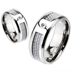 Beautiful mirror polished titanium ring with a brilliant white carbon fiber inlay and a single CZ accent. For men and women. Perfect for couples.  Wholesale Titanium Rings & Wedding Bands. www.925express.com
