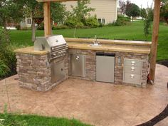 Outdoor island grill...looks exactly like the one my dad built!