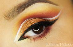 Makeup Geek Duochrome Eyeshadows in Karma and Voltage + Makeup Geek Eyeshadows in Bitten, Lemon Drop, Mango Tango and Razzleberry. Look by: Bulineska Makeup