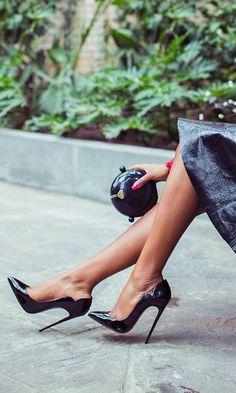 Christian Louboutin black pumps