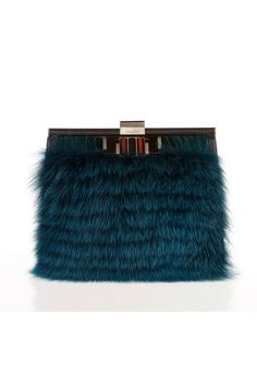 Does THIS really justifies the suffering and death of an animal?? It is so incredible sad and heartbeaking for all those poor creatures who had to die for such a dispensable item! (Purse by Oscar de la Renta)