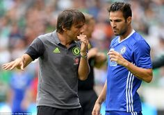 Cesc Fabregas is given instructions by Antonio Conte as the Spaniard comes on at half-time for Chelsea