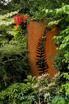 This could simply be garden art, but it could also be a secret garden gate.  (CorTen has so many outdoor uses!)  Darcy Garden_070