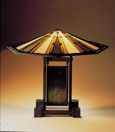 "Table Lamp, from the Susan Lawrence Dana House, Springfield, Illinois, 1902""4 Leaded glass, bronze, brass, and zinc Base; LACMA, gift of Max Palevsky © Frank Lloyd Wright / Artists Rights Society (ARS), NY. Placque made by Margaret Macdonald Mackintosh (Scottish, b. England, 1864""1933)"