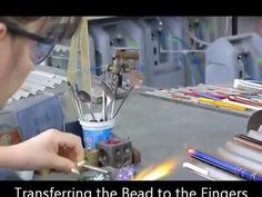Watch our bead makers blow a glass bead. This is how you can make beads even if you are not in a furnace. Start with glass canes! Make a Bubble, It looks easy??