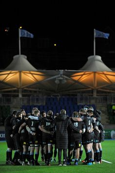 Glasgow players form a group huddle on the pitch after the European Champions Cup pool 3 rugby union match between Glasgow Warriors and Montpellier at Scotstoun Stadium in Glasgow, Scotland on December won the game / AFP PHOTO / Andy BUCHANAN Today In Pictures, Glasgow Scotland, Montpellier, Pitch, Rugby, Warriors, Champion, Basketball Court, December